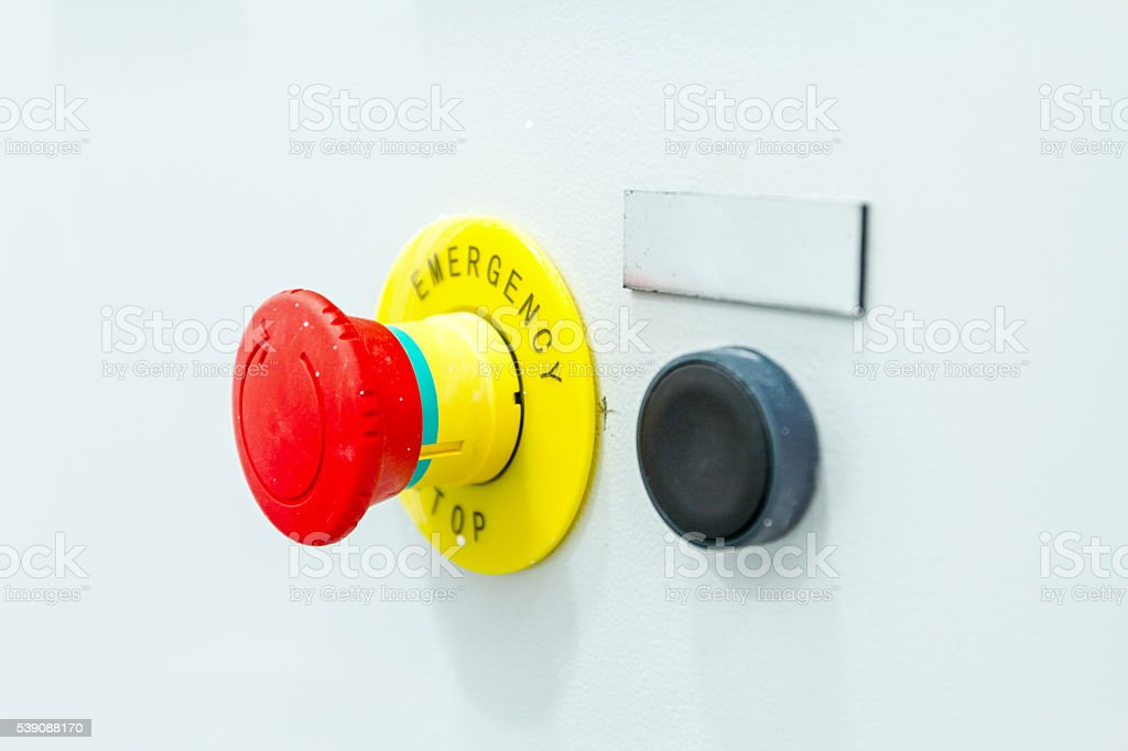Red emergency stop and black reset button stock photo