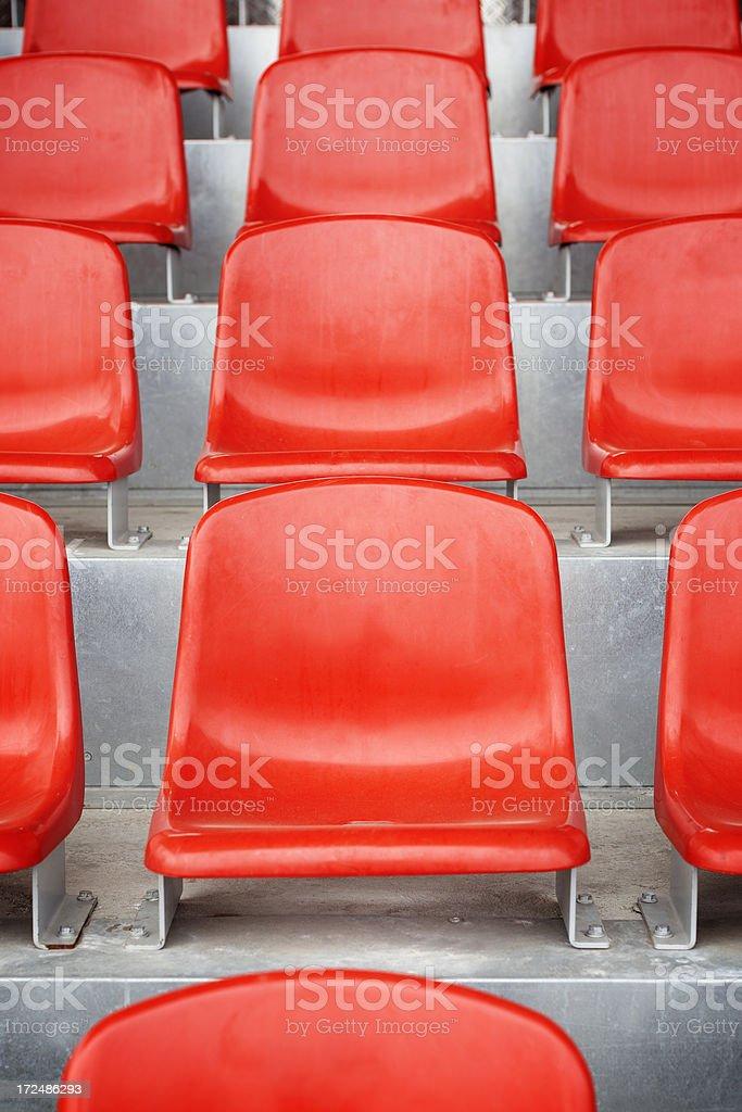 Red empty stadium seats royalty-free stock photo