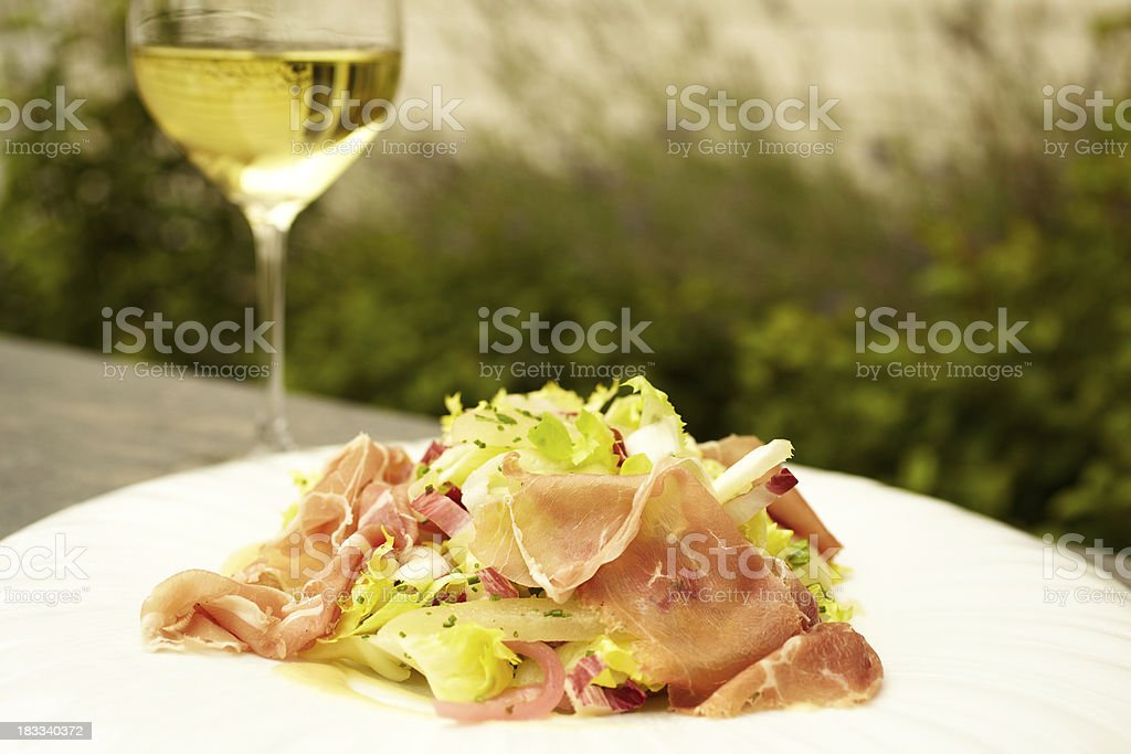 Red endive and escarole salad with prosciutto stock photo