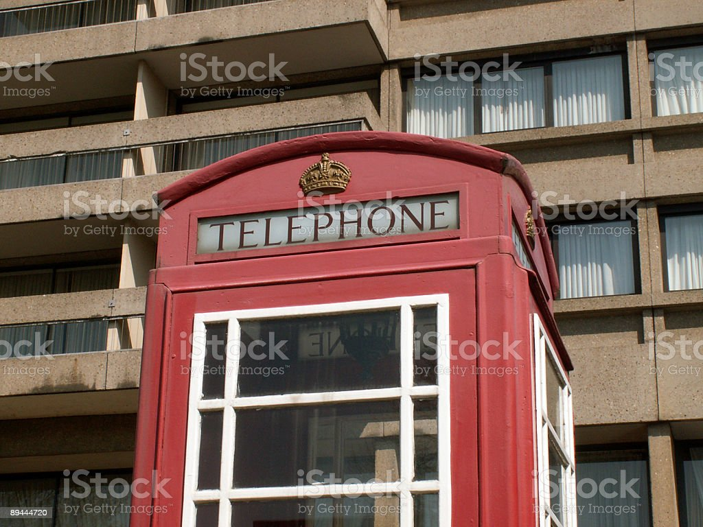 Red english phone box in front of a hotel royalty-free stock photo