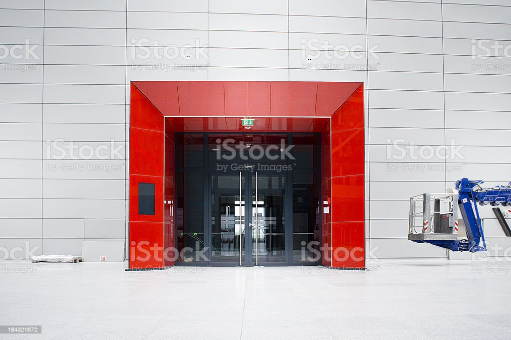 Red entrance and blue manlift stock photo