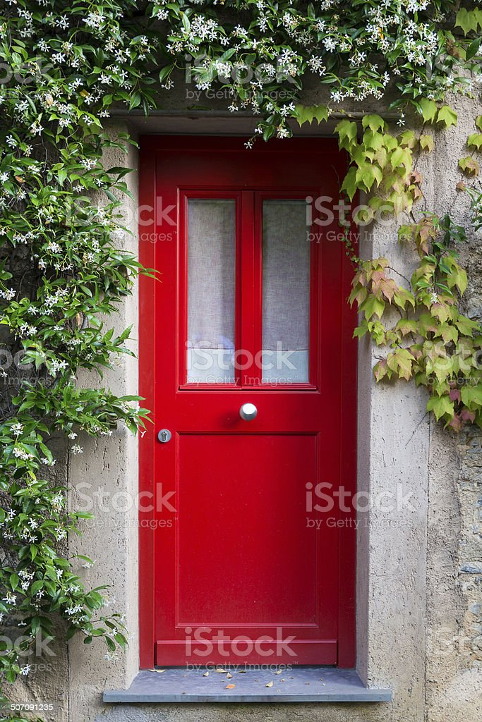 Red Entrance Door with jasmine flowers stock photo