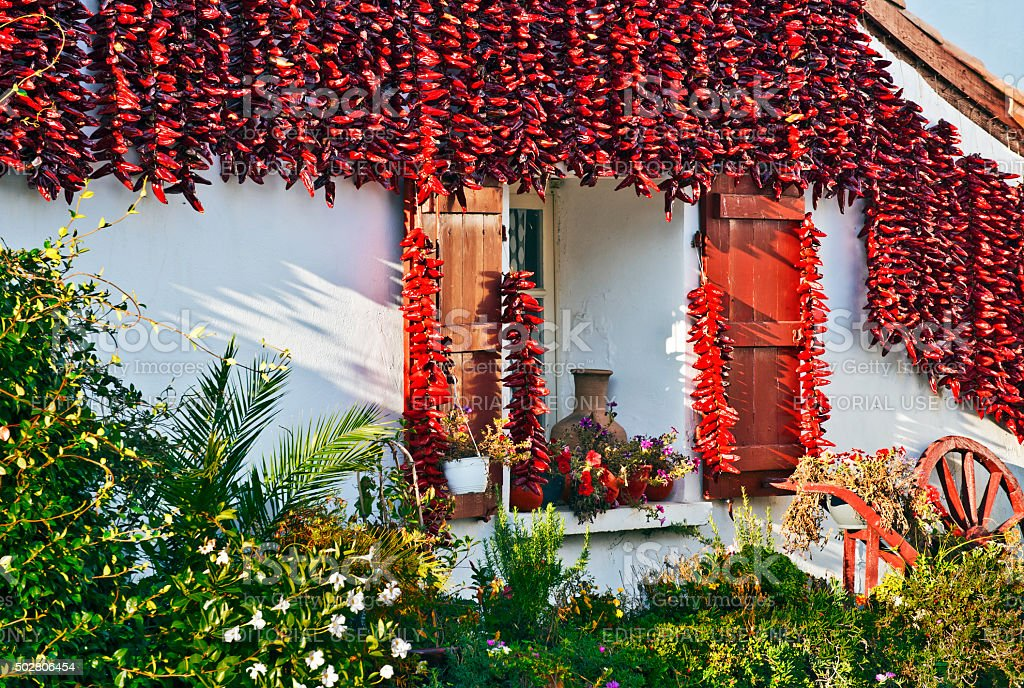 Red Espelette peppers decorating Basque house stock photo