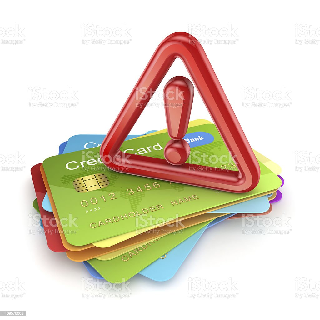 Red exclamation sign on a stack of credit cards. stock photo