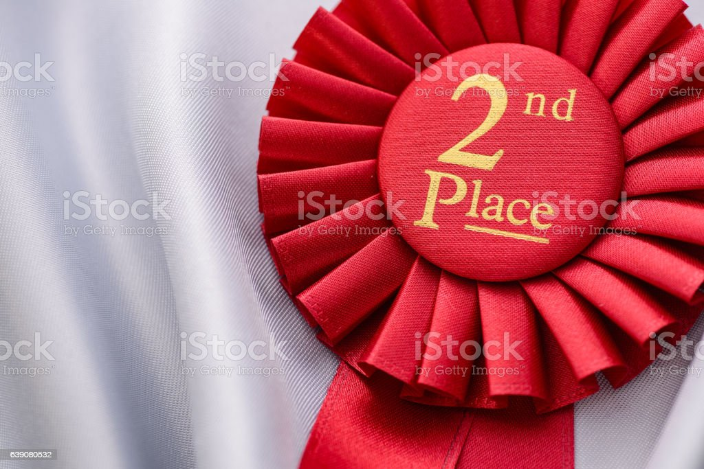 Red fabric award ribbon for the 2nd place stock photo