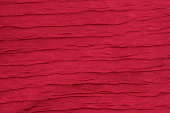 Red fabric background wave like closeup