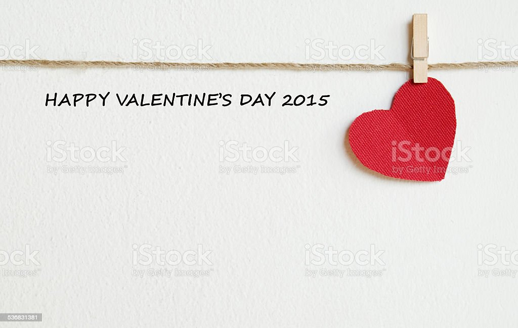 Red fabric heart with happy valentine's day 2015 words stock photo