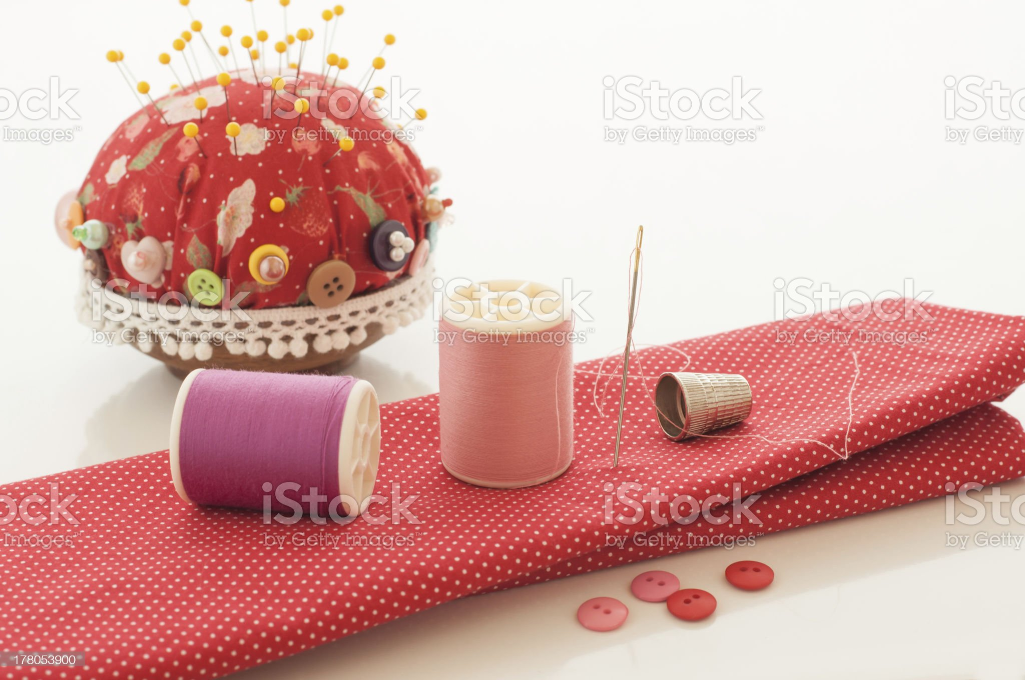 Red fabric, thread and other sewing tools. royalty-free stock photo