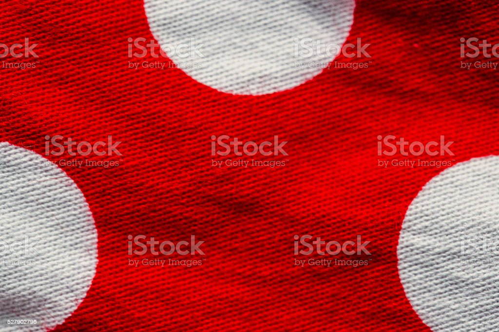 Red fabric with the white polka dots stock photo
