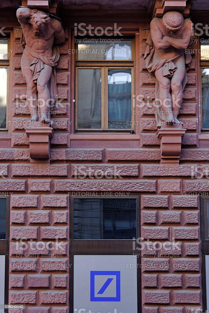 red facade with Deutsche Bank sign stock photo