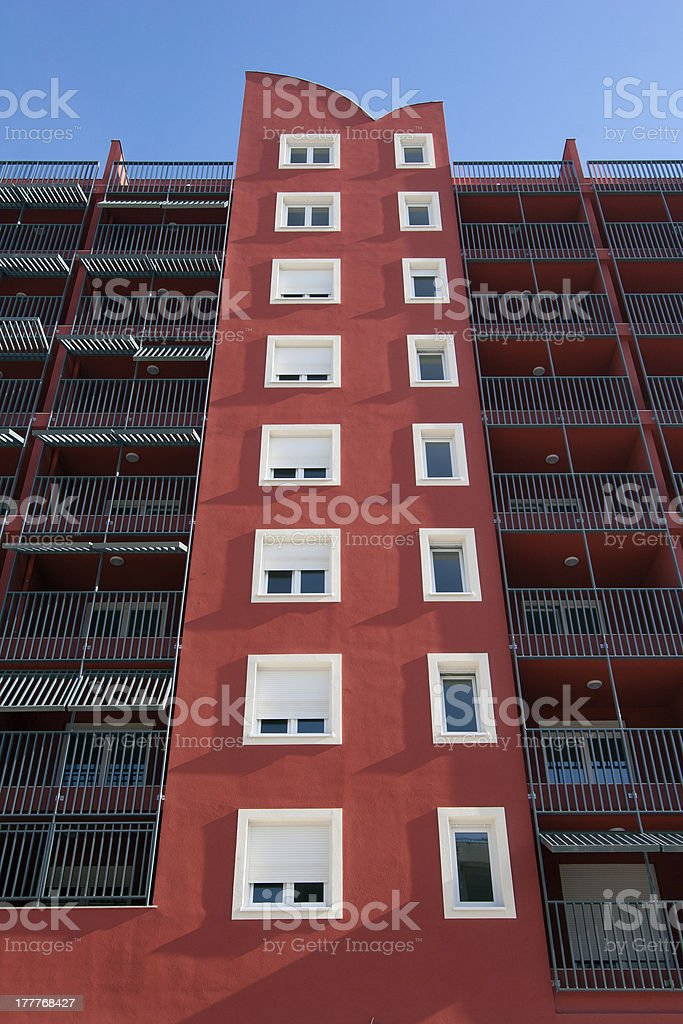 Red facade with white windows and balconys royalty-free stock photo