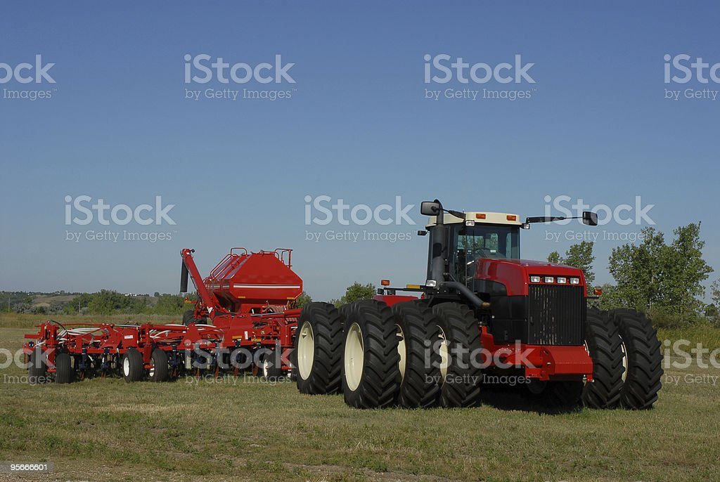 Red farm tractor outside in the grass royalty-free stock photo