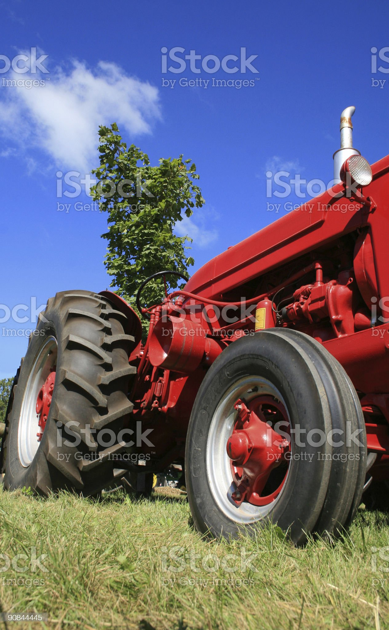 red farm tractor royalty-free stock photo