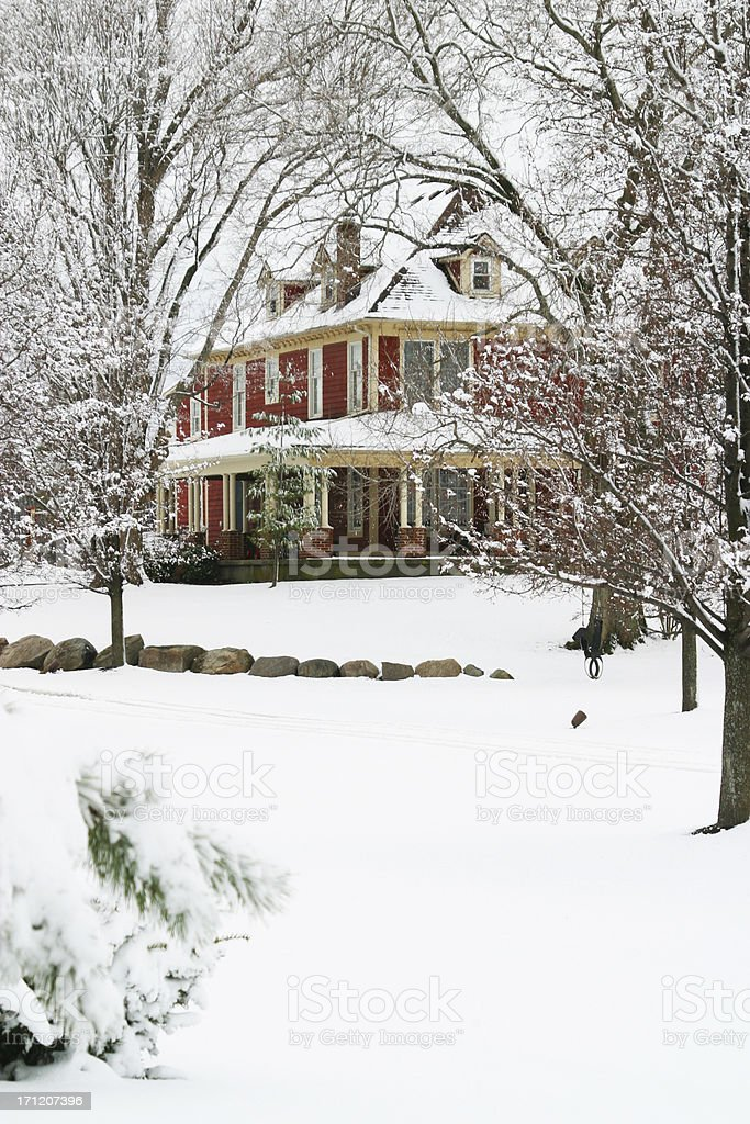 Red Farmhouse In The Winter Snow royalty-free stock photo