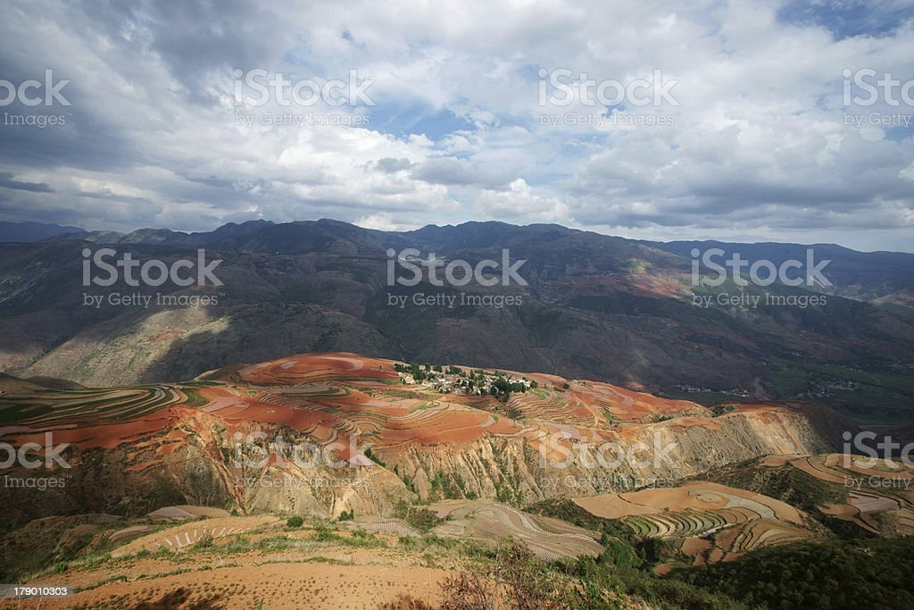 Red farmland with village in dongchuan of china royalty-free stock photo