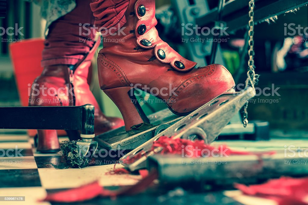Red Fashion Boots Of Seamstress on Sewing Machine stock photo