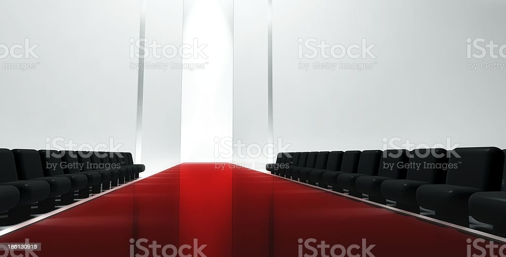 Red Fashion runway with empty black chairs stock photo