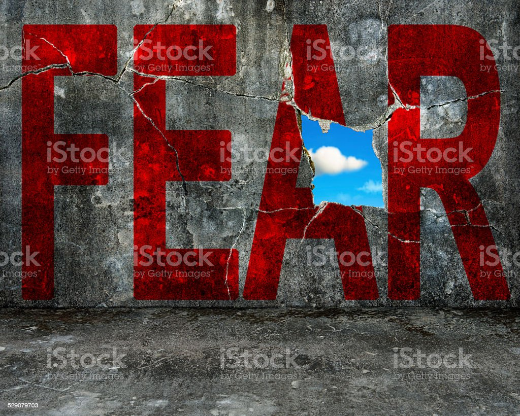 red FEAR word on grey grunge concrete wall stock photo