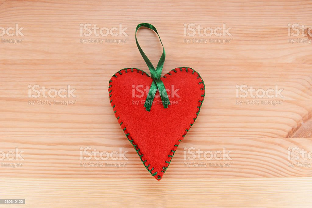 Red felt heart ornament with green ribbon stock photo
