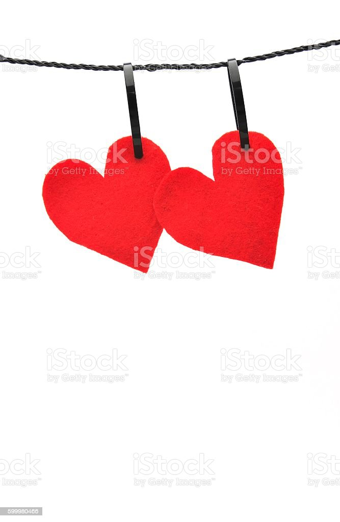 Red felt hearts hanging side by side foto de stock libre de derechos