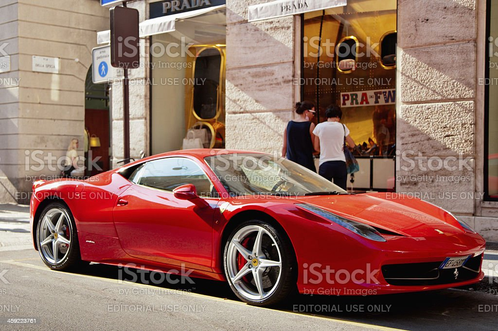 Red Ferrari at Prada Store Milan Italy stock photo