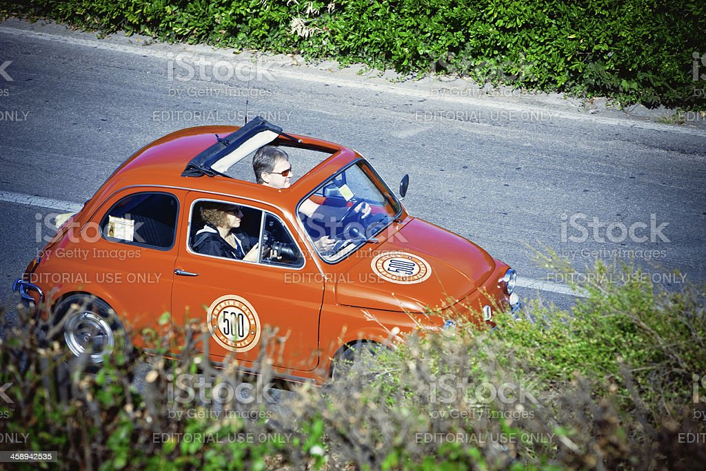 Red Fiat with Two Tourists inside in Florence, Italy royalty-free stock photo