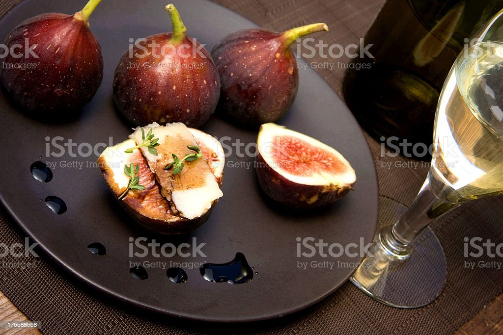 Red figs with balsamic vinegar and goat cheese stock photo