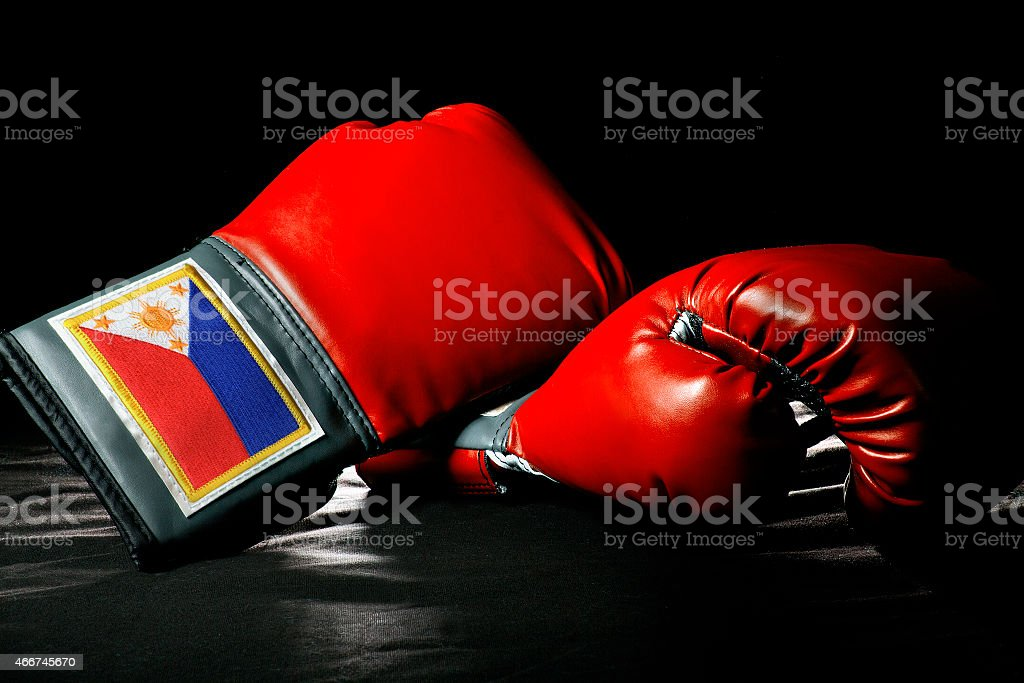 Red Filipino Boxing Gloves on a Black Background stock photo