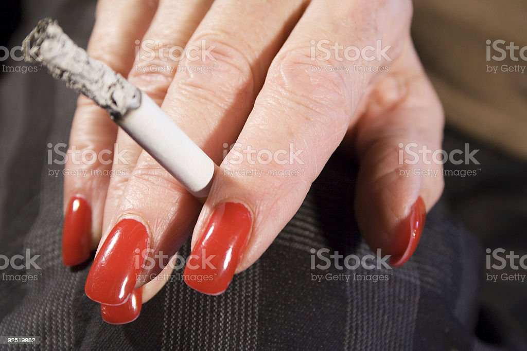 Red Fingernails and Cigarette (Front View) stock photo