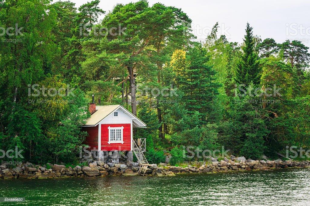 Red Finnish Wooden Bath Sauna Log Cabin Island, Summer stock photo