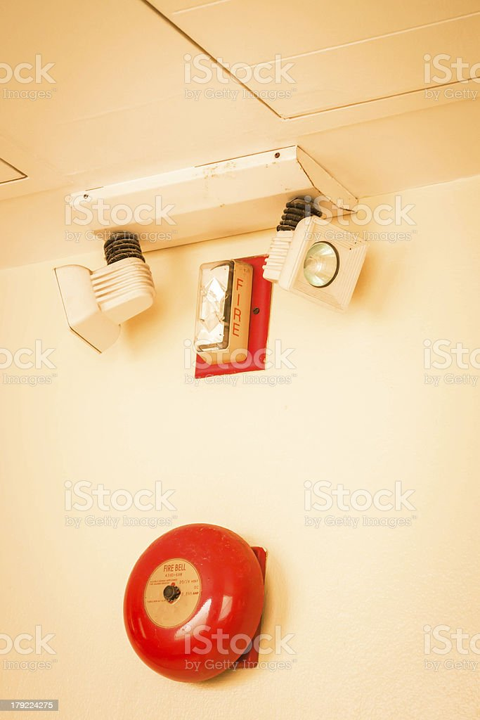Red fire alarm bell in the building royalty-free stock photo