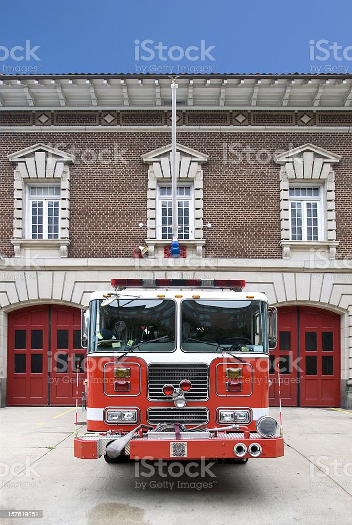 Red Fire Engine in front of  a Fire Station. stock photo