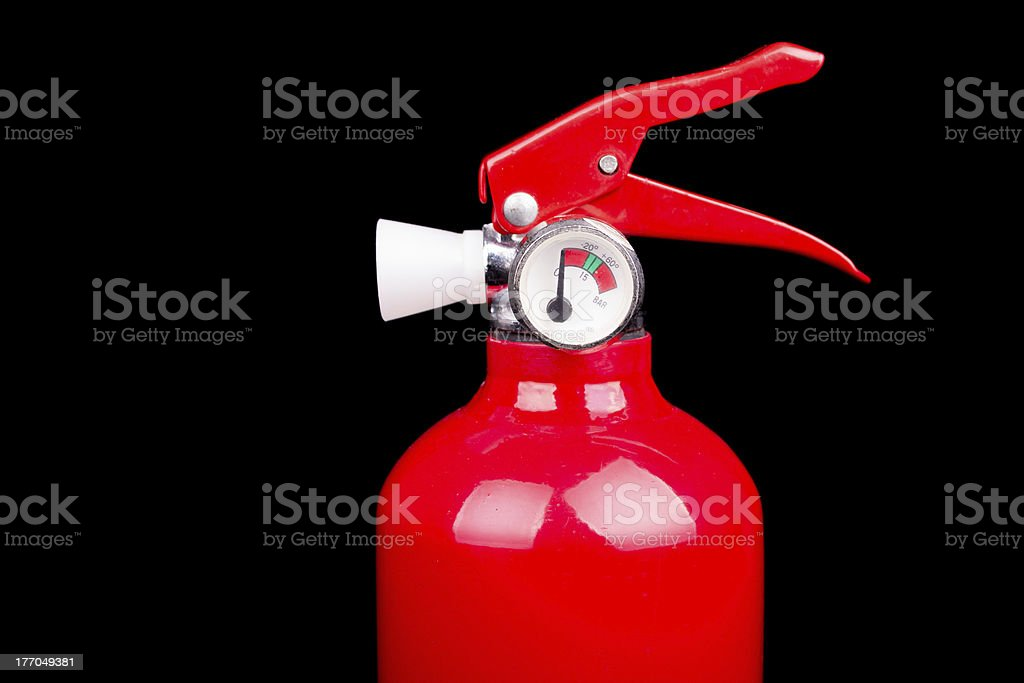 Red fire extinguisher isolated on a black background royalty-free stock photo