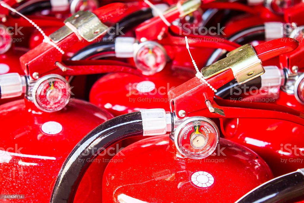 Red fire extinguishers stock photo