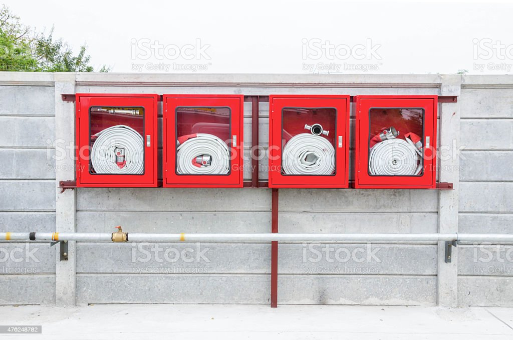 Red Fire Hose Cabinet stock photo