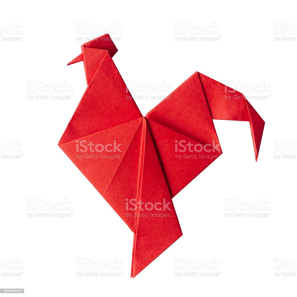 Red fire paper folded rooster handmade origami stock photo