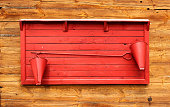Red fire point stand mounted on wooden wall