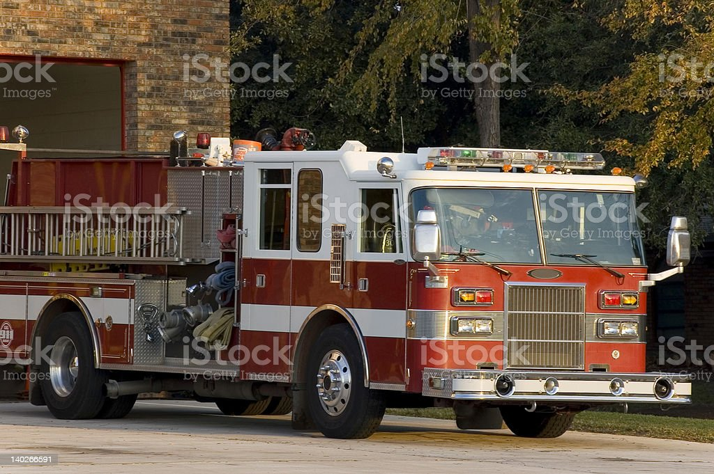 Red fire truck parked at station stock photo