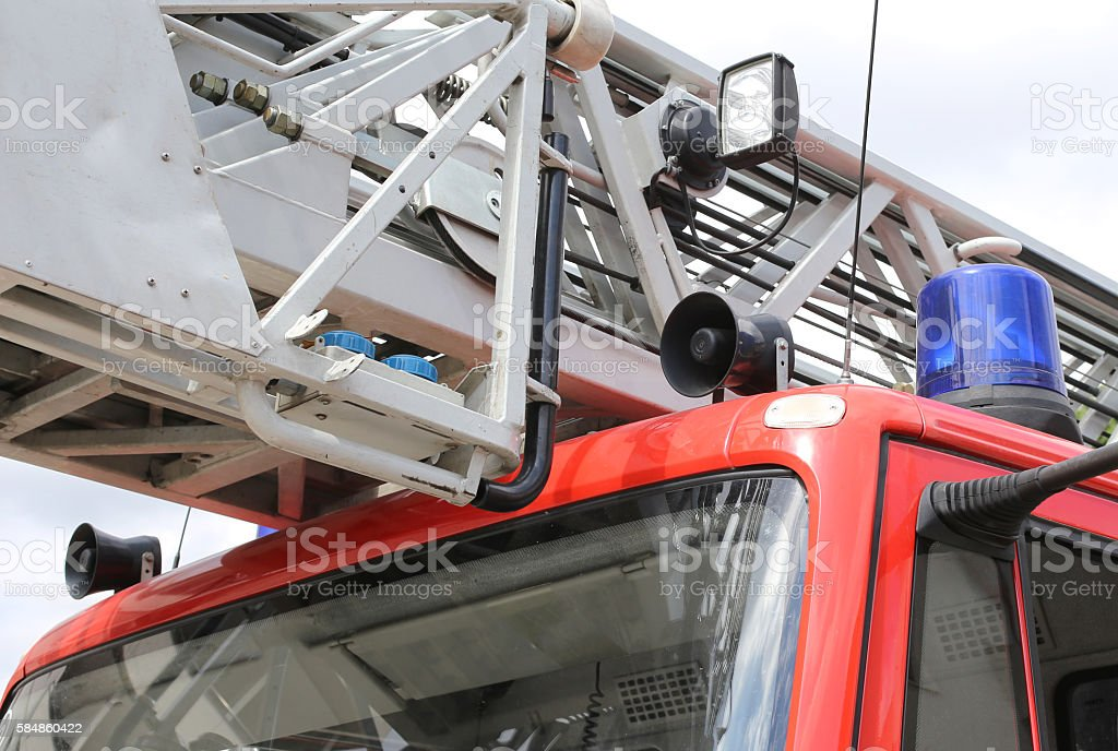 red fire truck with blue siren stock photo