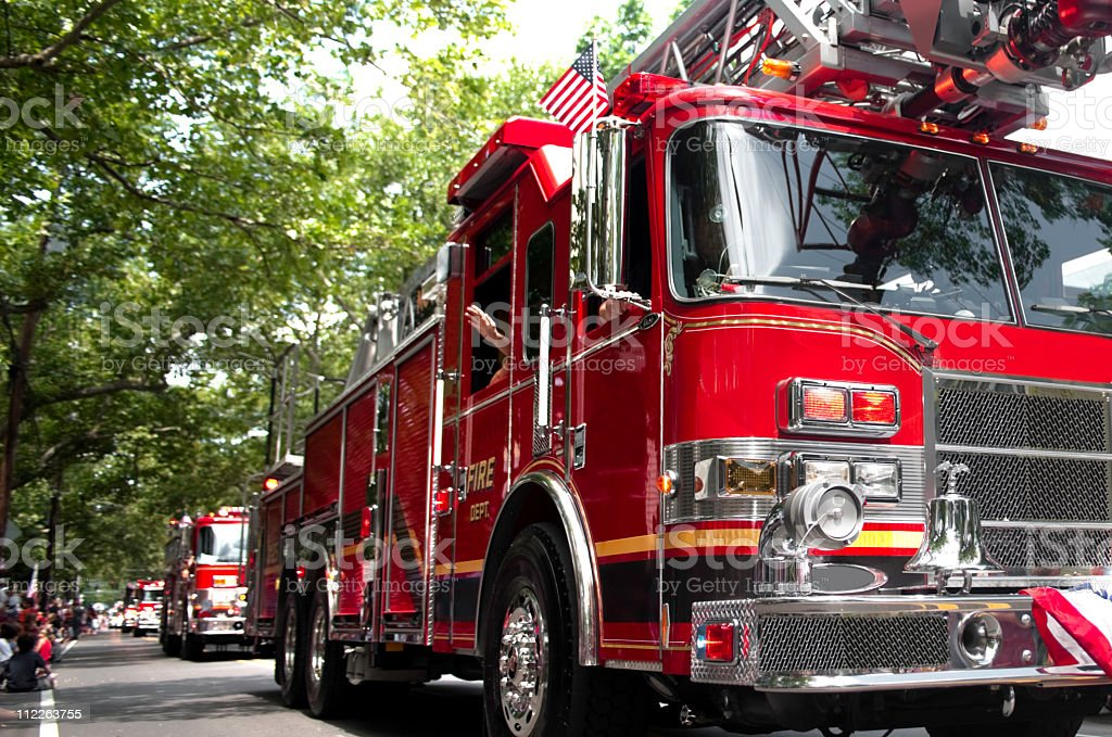 red fire trucks in parade stock photo