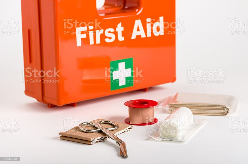 A red first aid box with supplies for dressings in front stock photo