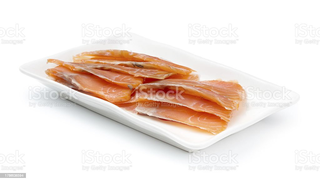 Red fish on white plate. Shallow dof. royalty-free stock photo