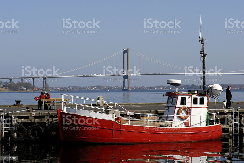 Red fishing boat in harbor stock photo
