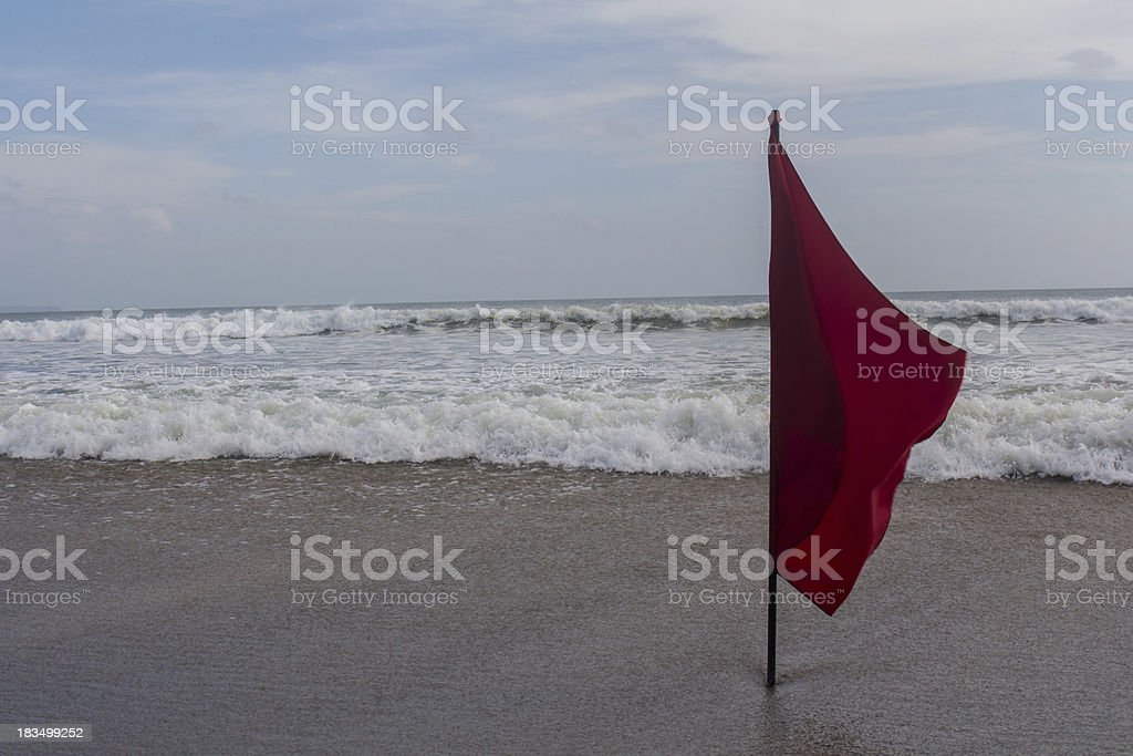 Red flag at the beach stock photo