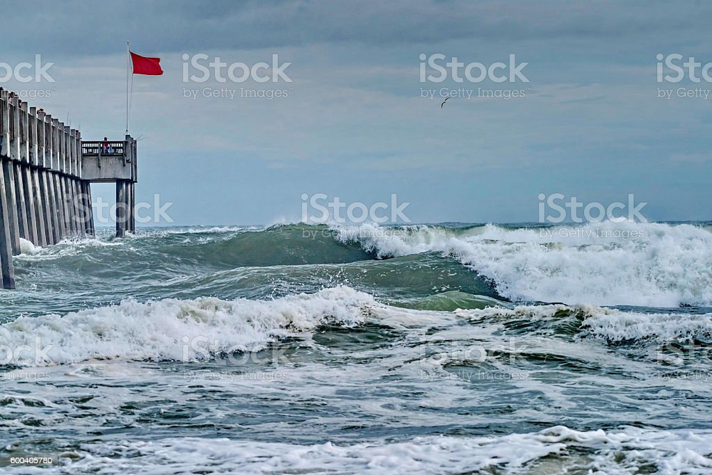 Red flag flying at the beach stock photo