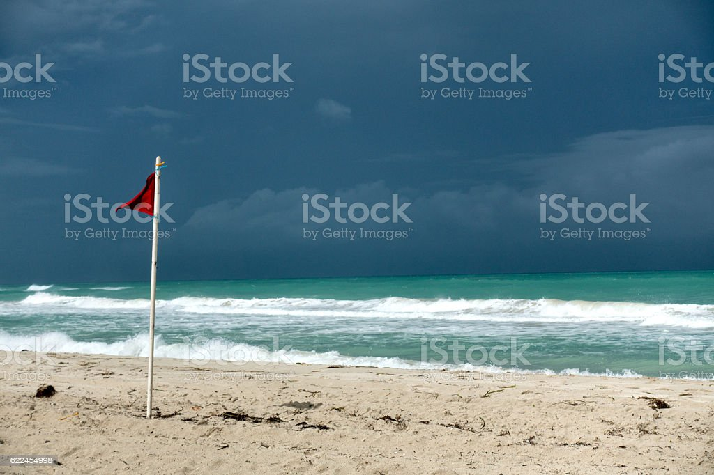 Red Flag on Beach in Cuba stock photo