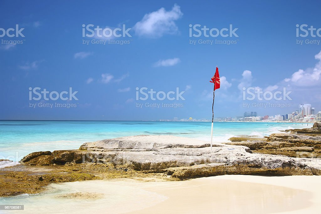 red flag on the beach royalty-free stock photo