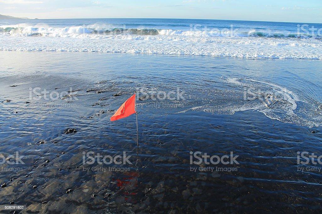 red flag warning of danger stock photo