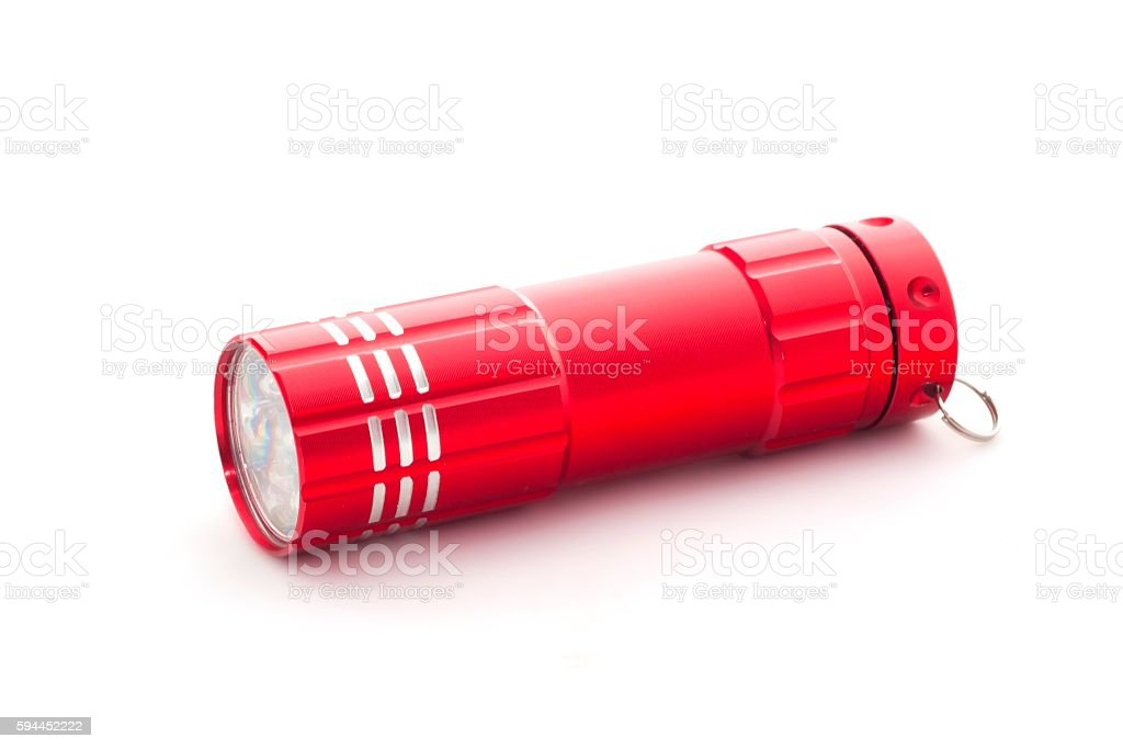 Red flashlight on white background stock photo