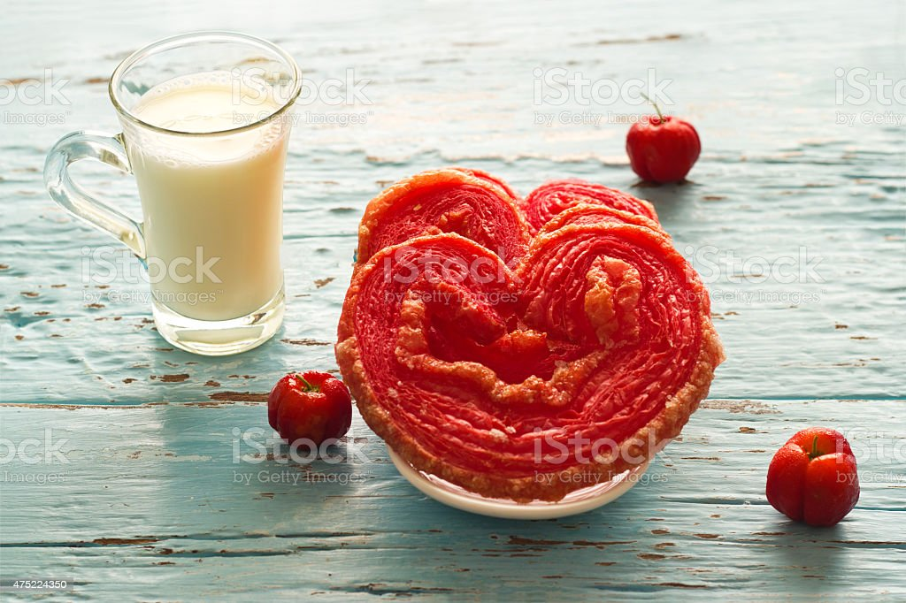 Red flavored puffed fried with milk on blue vintage tone stock photo